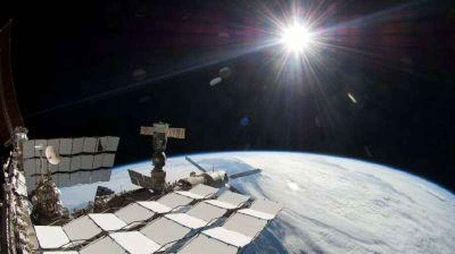 Into the dark: A $2 billion cosmic ray detector on the International Space Station has found the footprint of what could be dark matter, the mysterious substance believed to hold the cosmos together. (The Associated Press)