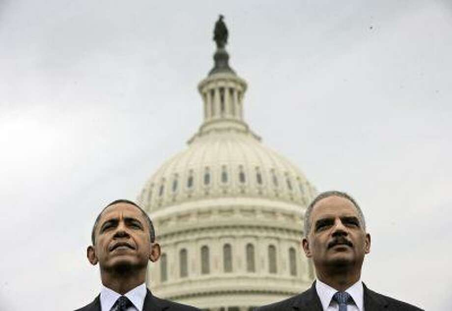 President Barack Obama sits with Attorney General Eric Holder during the 32nd annual the National Peace Officers Memorial Service, Wednesday, May 15, 2013, on Capitol Hill in Washington, honoring law enforcement officers who died in the line of duty. (AP Photo/Pablo Martinez Monsivais) Photo: AP / AP