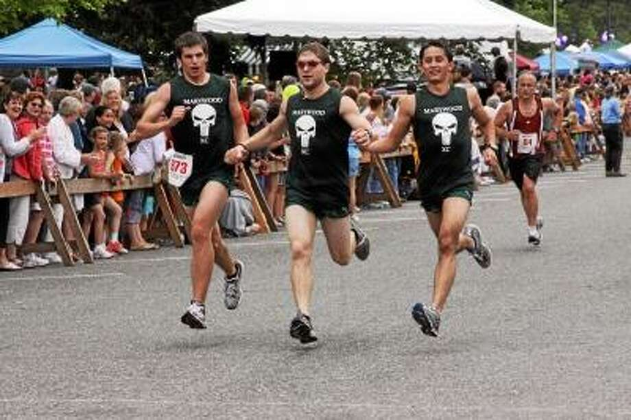 Laurie Gaboardi/Register Citizen  Three runners finishing the Litchfield Hills Road Race last year.