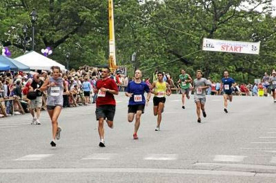 Register Citizen File Photos - Runners compete in the annual Litchfield Hills Road Race.
