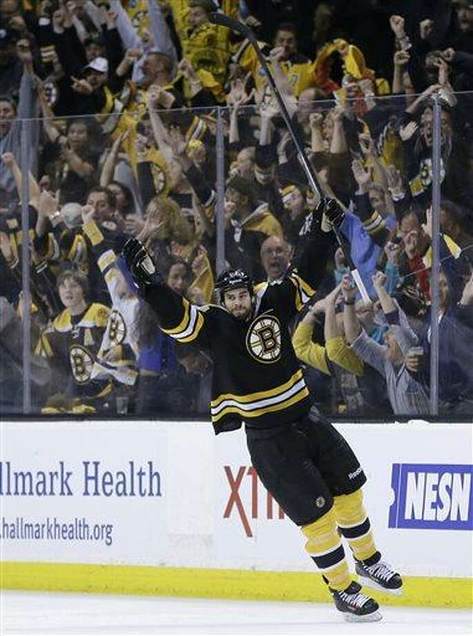Boston Bruins defenseman Adam McQuaid  celebrates his goal against the Pittsburgh Penguins during the third period of Game 4 in the Eastern Conference finals of the NHL hockey Stanley Cup playoffs, in Boston on Friday, June 7, 2013. (AP Photo/Elise Amendola) Photo: AP / AP