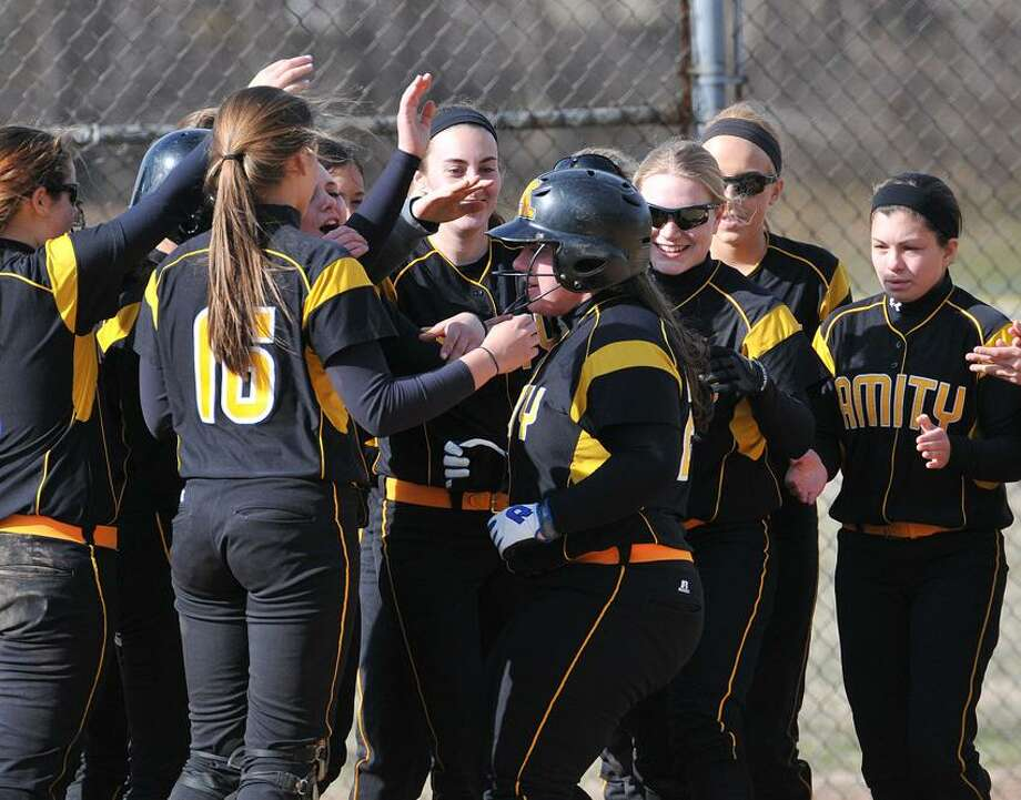 """Amity's Heather Ferranti gets greeted at the plate after a towering 2-run homer in the fifth inning of Amity's win over East Haven. Photo-Peter Casolino/Register  <a href=""""mailto:pcasolino@newhavenregister.com"""">pcasolino@newhavenregister.com</a>"""