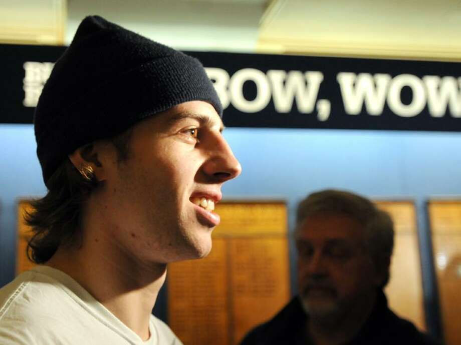 Yale University hockey player Jesse Root, right after  a press conference at Yale's Ingalls Rink Thursday, April 4, 2013. The Yale hockey team is traveling to the Frozen Four NCAA Hockey Championship in Pittsburg.  Photo by Peter Hvizdak / New Haven Register. Photo: New Haven Register / ©Peter Hvizdak /  New Haven Register