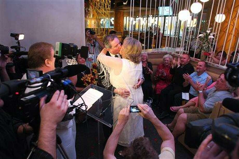 Nancy Levindowski and Steve Keller kiss after exchanging wedding vows at the Denny's restaurant on Fremont Street in Las Vegas, Wednesday, April 4, 2013. The Associated Press photo. Photo: AP / The Las Vegas Sun