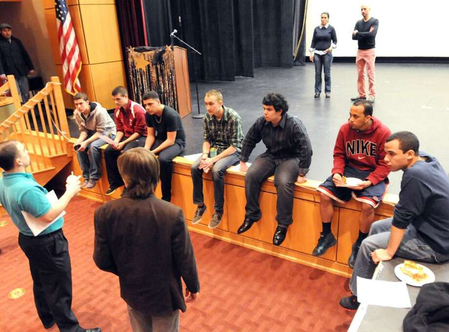 North Haven High School teachers Dan O'Brien, left, and Chris Moore, right, give instruction to some of the high school student participants of the Mr. North Haven Pageant as high school assistant principal Sandra Preneta and principal Dr. Russell J.  Dallai observe, rear right in photo, during a rehearsal in the school's auditorium Wednesday evening  April 3, 2013. Photo by Peter Hvizdak / New Haven Register. Photo: New Haven Register / ©Peter Hvizdak /  New Haven Register