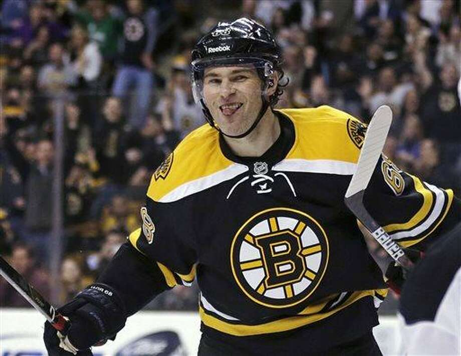 Boston Bruins right wing Jaromir Jagr sticks out his tongue after scoring in the second period of an NHL hockey game against the New Jersey Devils in Boston, Thursday, April 4, 2013. (AP Photo/Charles Krupa) Photo: AP / AP
