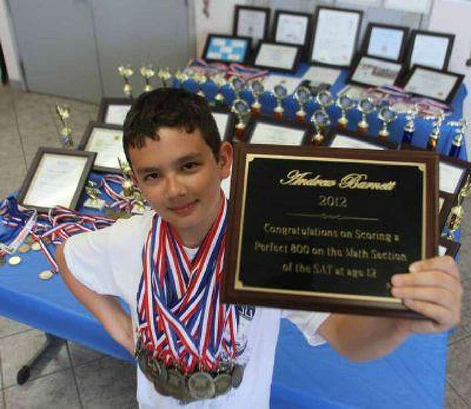 Andrew Barnett shows a plaque which commemorates his perfect 800 score on the SAT. (Victor Calzada/El Paso Times) / El Paso Times