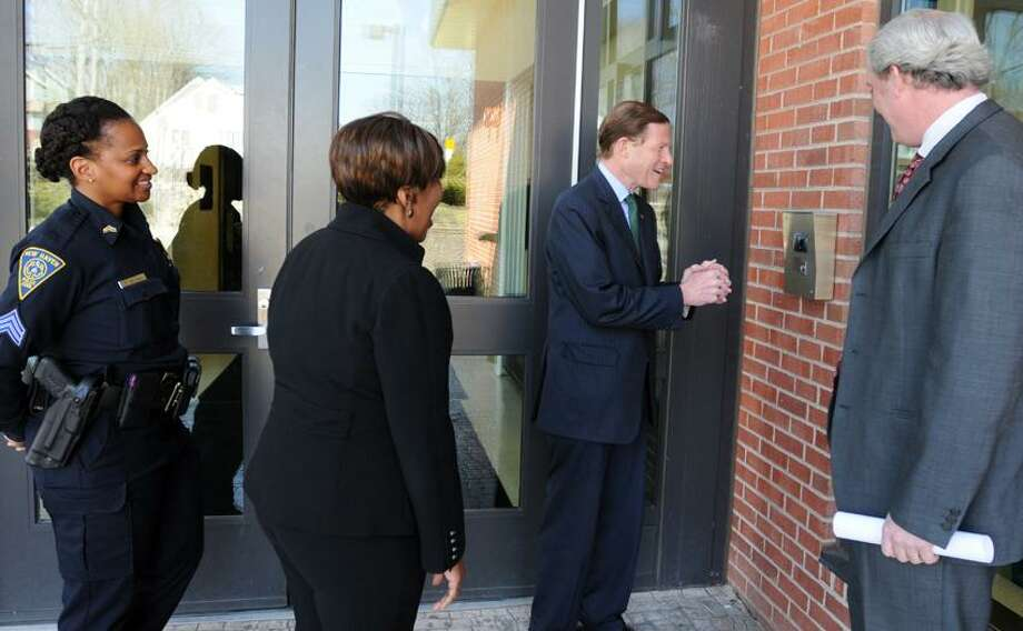 U.S. Senator Richard Blumenthal (D-Conn.), third from left,  talks through a security-camera intercom system as he visits Ross-Woodward School in New HavenThursday, April 4, 2013 to learn about its safety features and the security needs of the school. With Blumenthal from left are New Haven Polce Sgt Tammi Means, school principal Cheryl Brown and New Haven COO Will Clark.  Photo by Peter Hvizdak / New Haven Register. Photo: New Haven Register / ©Peter Hvizdak /  New Haven Register
