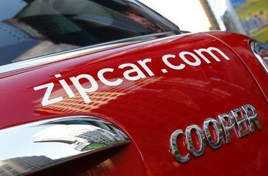 """The <a href=""""http://Zipcar.com"""">Zipcar.com</a> logo is seen on a Mini Cooper car during a promotional event in New York's Times Square April 14, 2011. Photo: REUTERS / X90033"""