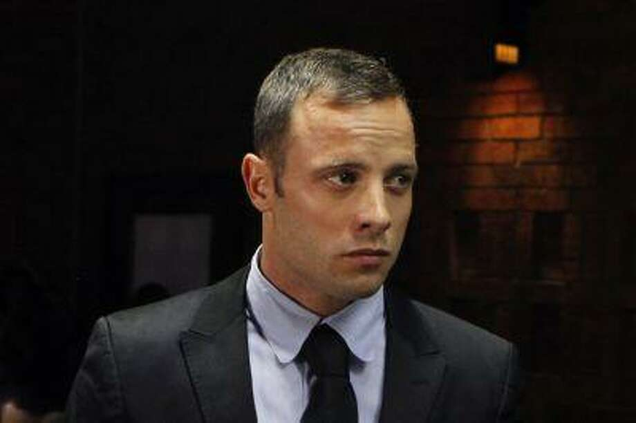 """Blade Runner"" Oscar Pistorius stands in the dock during a break in court proceedings at the Pretoria Magistrates court February 20, 2013. A witness heard ""non-stop shouting"" in the home of South African athletics star Pistorius shortly before his girlfriend Reeva Steenkamp was shot dead, the detective leading the murder investigation said on Wednesday. The athlete's defence team disputed the finding. REUTERS/Siphiwe Sibeko (SOUTH AFRICA - Tags: CRIME LAW SPORT OLYMPICS HEADSHOT TPX IMAGES OF THE DAY PROFILE) Photo: Reuters / X01918"