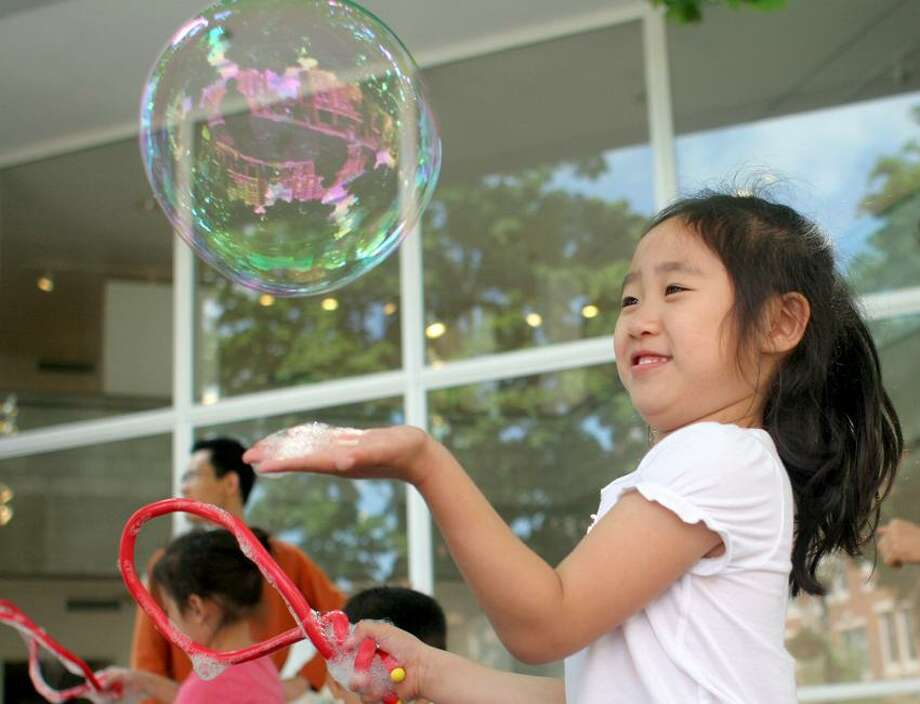 Amanda May photo: Creative Arts Workshop offers a variety of hands-on fun, including bubblemaking.