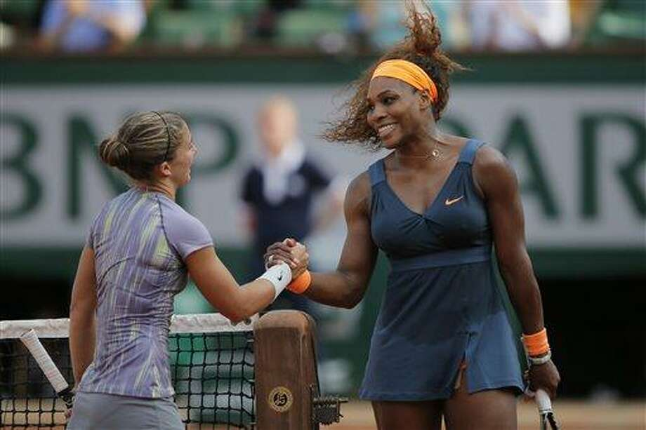 Serena Williams of the U.S., right, shakes hands with Italy's Sara Errani after defeating Errani in two sets 6-0, 6-1, in their semifinal match at the French Open tennis tournament, at Roland Garros stadium in Paris, Thursday June 6, 2013. (AP Photo/Michel Spingler) Photo: AP / AP