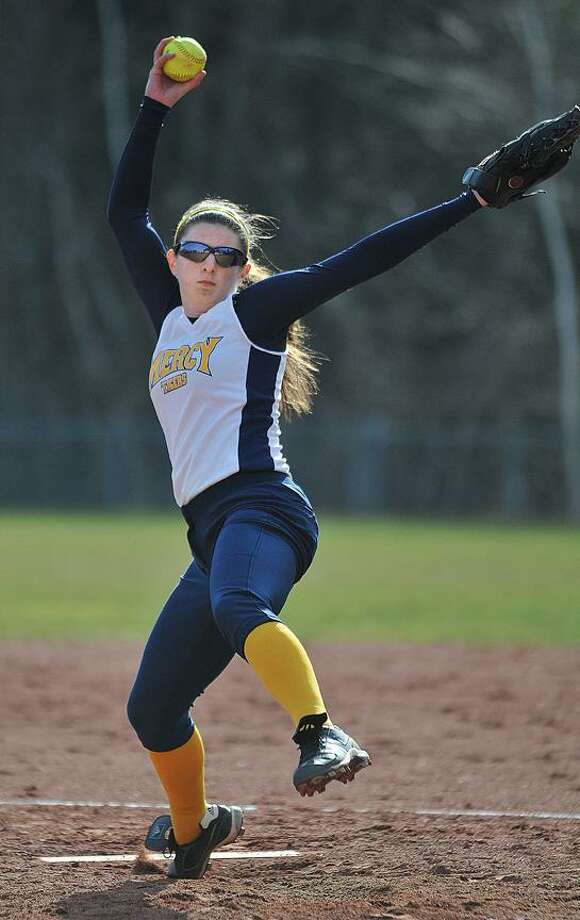 Catherine Avalone/The Middletown Press Mercy's Mary Adametz on the mound against Jonathan Law-Milford Thursday afternoon. Mercy defeated the Lawmen 3-2 at home. / TheMiddletownPress