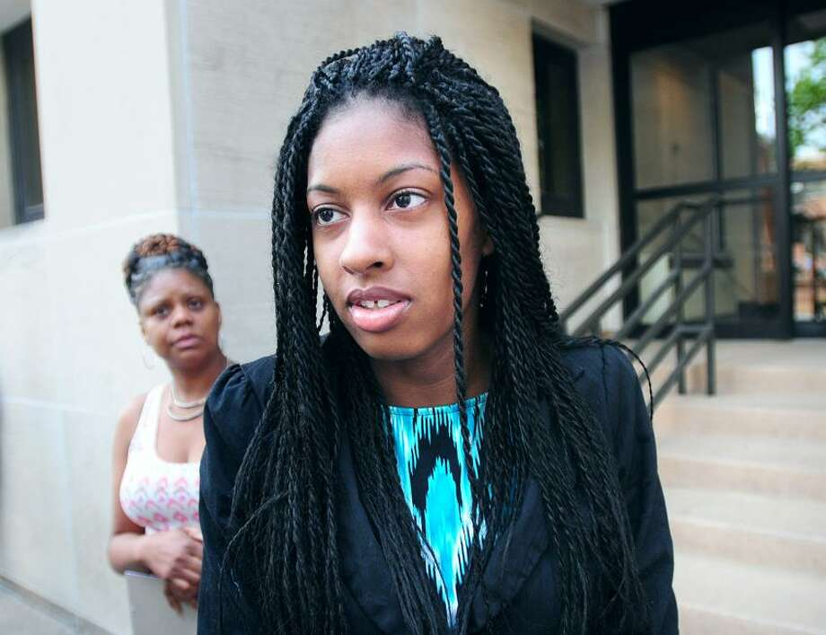 LaToya Boomer (center) leaves Superior Court in New Haven after the sentencing of Kenneth McCoy for the murder of Boomer's husband, Dallas, on 6/6/2013.Photo by Arnold Gold/New Haven Register  AG0502A