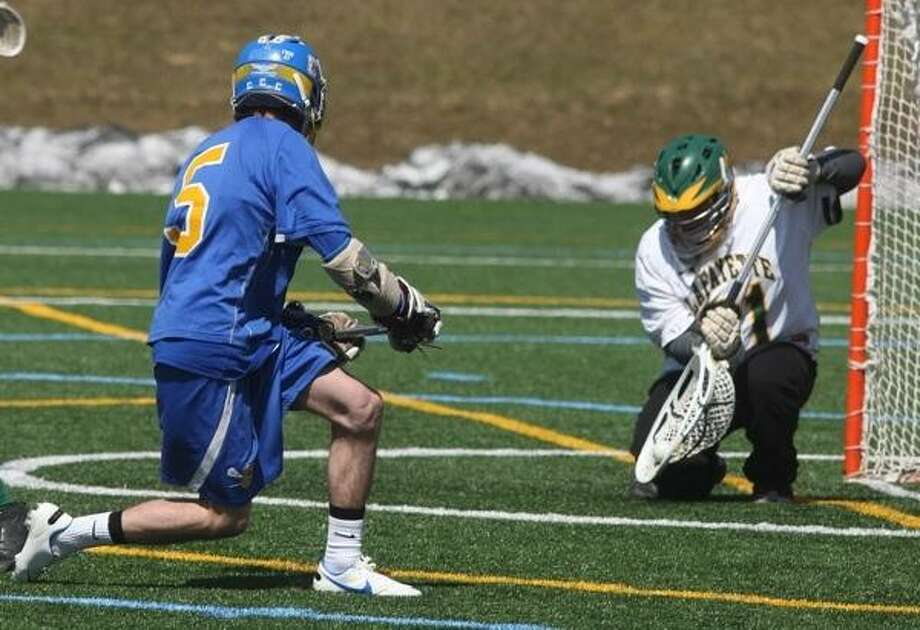 John Haeger @OneidaPhoto on Twitter/Oneida Daily Dispatch Cazenovia's Conor Race (5) has his shot blocked by Lafayette goalie Elliot Lyons during the third quarter of their game on Thursday, April 4, 2013 in Cazenovia.