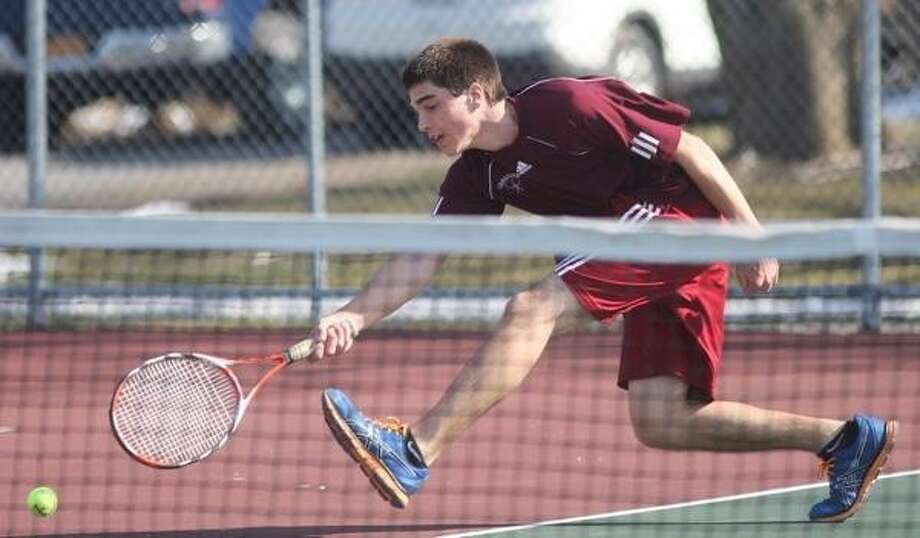 John Haeger @OneidaPhoto on Twitter/Oneida Daily Dispatch Canastota's Ross Braue reaches to return a shot from Westmoreland's Zach Dunning in the first game of their first singles match in Canastota on Thursday, April 4, 2013. Photo: Oneida Daily Dispatch / Oneida Daily Dispatch