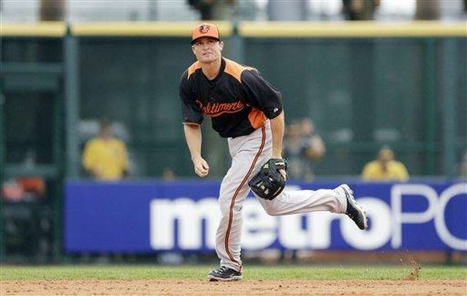 Baltimore Orioles outfielder Adam Greenberg watches the path of a fly ball during the sixth inning of an exhibition spring training baseball game against the Pittsburgh Pirates, Sunday, March 24, 2013 in Bradenton, Fla. (AP Photo/Carlos Osorio) Photo: ASSOCIATED PRESS / AP2013