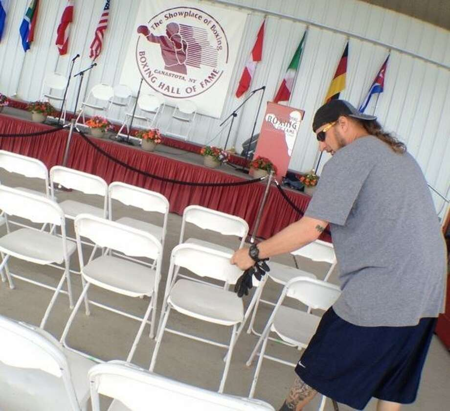 JOHN HAEGER @ONEIDAPHOTO ON TWITTER/ONEIDA DAILY DISPATCH Pete Amante of Las Vegas  NV works to set up chairs at the International,Boxing Hall of Fame in Canastota as the hall prepares for the 24th annual induction weekend on Wednesday, June 5, 2013.
