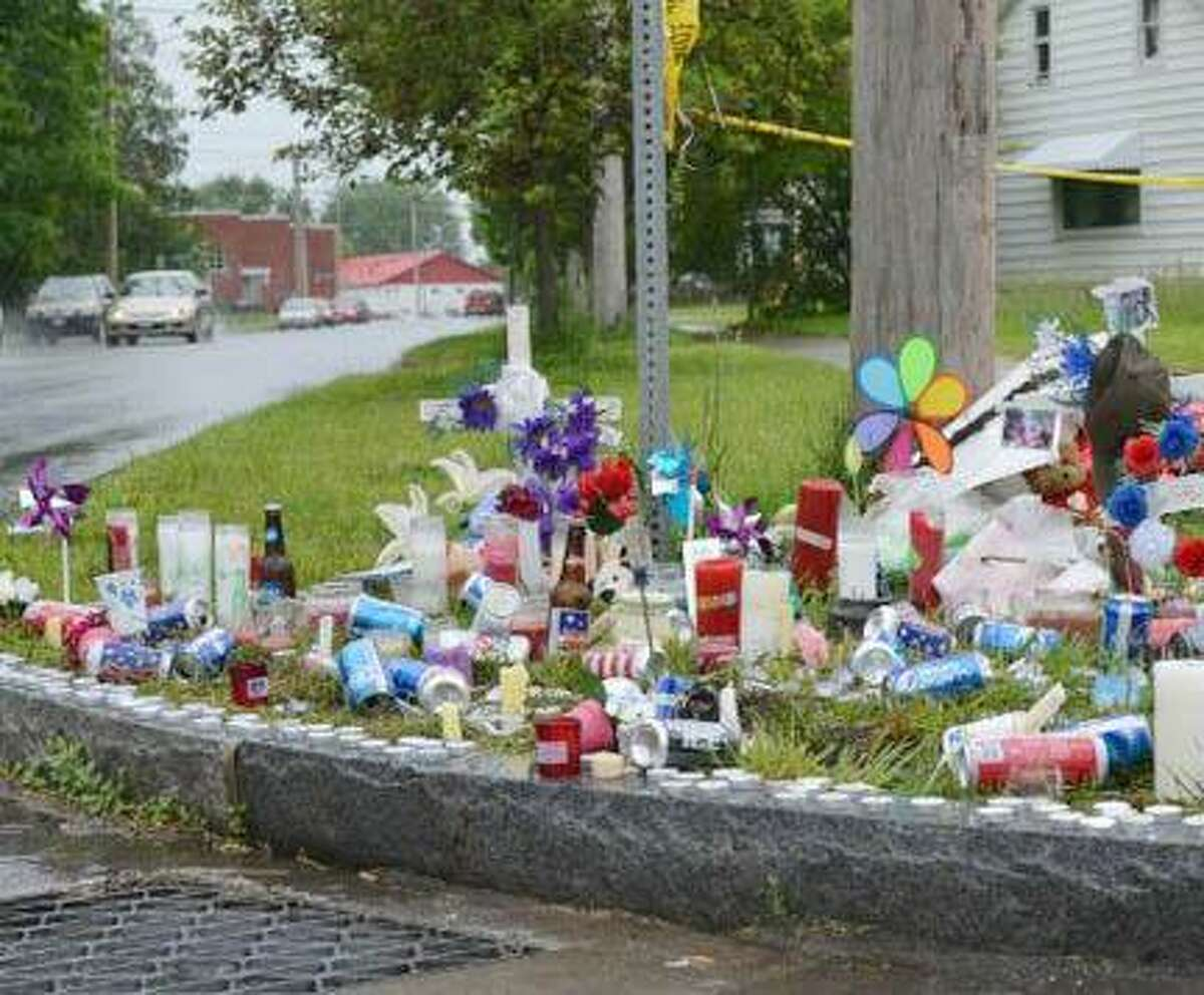 A memorial is set up by family and friends of victims Stephanie Morrison and Shawn Kessler filled with candles, letters, pictures and flowers on the corner of Floyd Avenue and Myrtle Street. It is placed nearby the residence where Aaron J. Welch allegedly stabbed them. Staff Photo BY RACHEL MURPHY