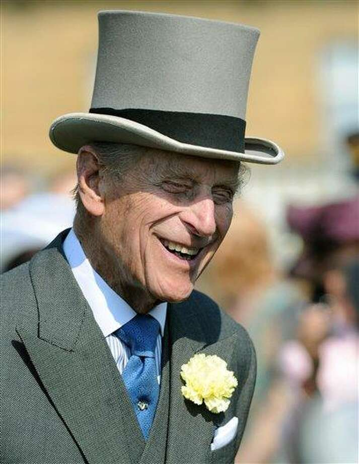 "The Duke of Edinburgh attending a Garden Party at Buckingham Palace, London Thursday June 6, 2013. Buckingham Palace says Queen Elizabeth II's husband was later admitted to a London hospital for an exploratory operation. The palace said the operation on 91-year-old Prince Philip will come after ""abdominal investigations,"" but did not elaborate. (AP Photo/ Anthony Devlin, pool) Photo: AP / PA Pool"