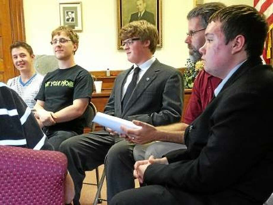Torrington High School students advocate to the Torrington Board of Education's policy committee, to loosen restrictions on electronic device use in the district. (Jessica Glenza/Register Citizen)