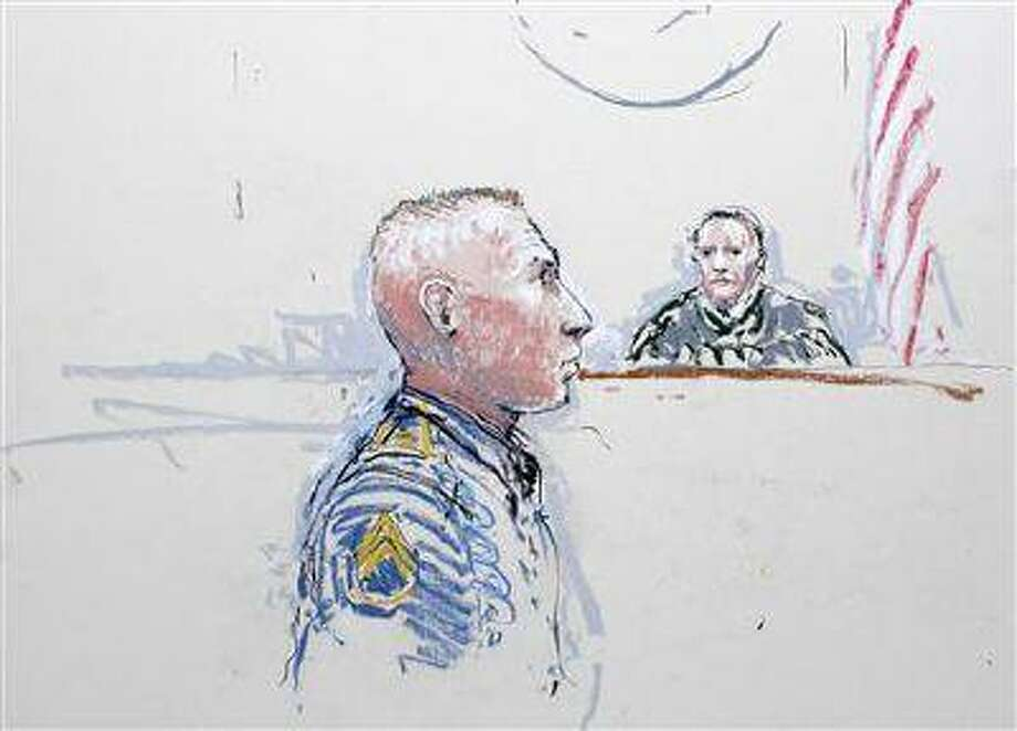 Army Staff Sergeant Robert Bales (L) and Judge Col. Jeffery R. Nance are seen in a sketch from January 17, 2013, as Bales is arraigned on 16 counts of premeditated murder, six counts of attempted murder and seven of assault at Joint Base Lewis-McChord, Washington. (Peter Millett/Reuters/Files)