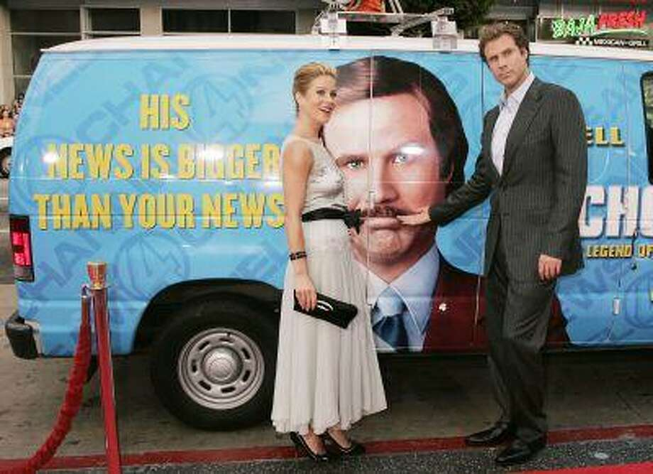 "Actor Will Ferrell and actress Christina Applegate pose next to a ""news van"" which they arrived in for the premiere of their new comedy film ""Anchorman The Legend of Ron Burgundy"" in Hollywood in this June 28, 2004, file photo. America's funniest fictional television news anchor Ron Burgundy from the 2004 comedy film ""Anchorman"" will be given the glass case treatment in a new exhibit on 1970s newsrooms, Washington D.C.'s Newseum said on June 4, 2013. REUTERS/Fred Prouser/Files Photo: REUTERS / X00224"