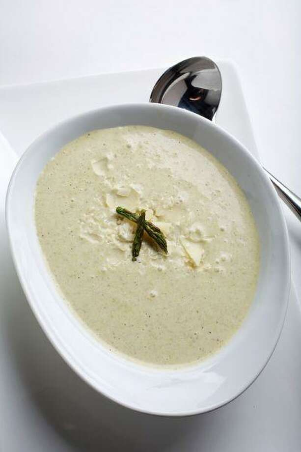 A charcoal fire and wood chips combine to give this elegant soup a smoky twist. Smoked Asparagus Soup. Photo: The Washington Post / WASHINGTON POST