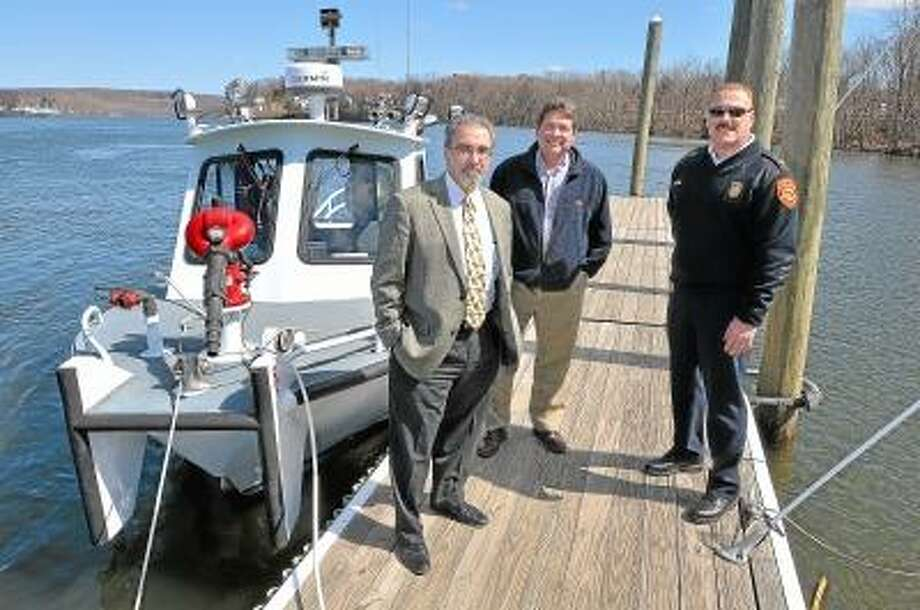 Catherine Avalone/The Middletown Press Guy Russo, Director of Middletown Water & Sewer, Jim Sipperly, Environmental Resource Specialist and Middletown Fire Chief Gary Ouelette, left to right, at the public safety dock on River Road. In order to accomodate Middletown, South Fire District, Police and the Harbor Master's boats, the city will add 40 feet to the current dock which is expected to be completed around Memorial Day. / TheMiddletownPress