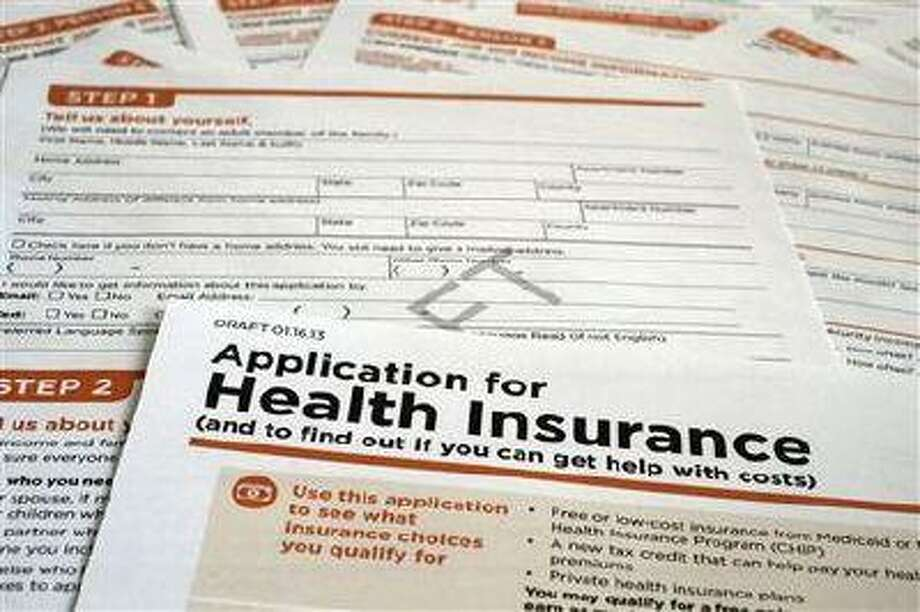 A draft copy of the Health and Human Services Department form proposed for use to apply for low-cost insurance from Medicaid or the Children's Health Insurance Program is photographed in Washington on Tuesday March 12, 2013. (J. David Ake/The Associated Press) Photo: AP / AP