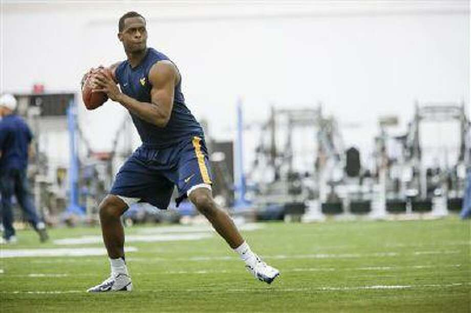 "Geno Smith during West Virginia University football pro day in Morgantown, <a href=""http://W.Va"">W.Va</a>., March 14, 2013. Photo: ASSOCIATED PRESS / AP2013"