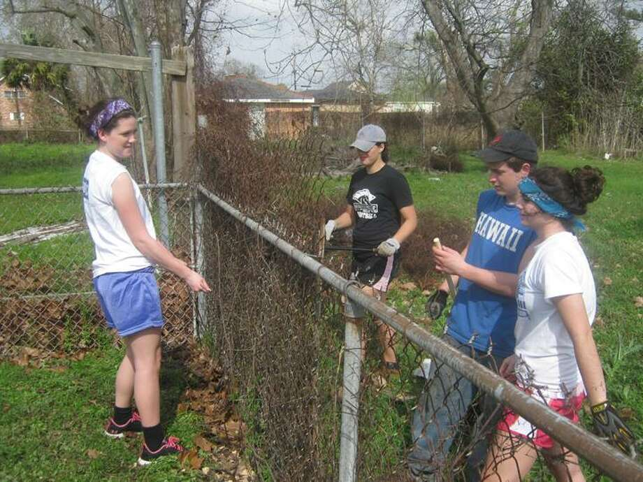 Photo Courtesy Morrisville-Eaton High School Brook Warner and Sara Collier, along with two others, help repair a fence as part of Southern Comfort last year. The girls will be heading south again this year during Spring Break.