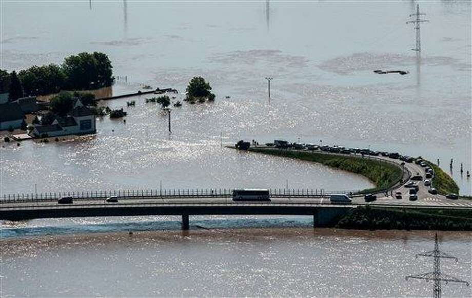 A view from  Radobyl  hill shows a highway and an exit to the village Mlekojedy flooded by the swollen river Elbe near Litomerice, 70 kilometres (43 miles) Northwest of Prague,  taken on Wednesday, June 5, 2013. Heavy rainfalls caused flooding in Germany, Austria, Switzerland and the Czech Republic. (AP Photo/CTK, Radek Petrasek) SLOVAKIA OUT Photo: AP / CTK
