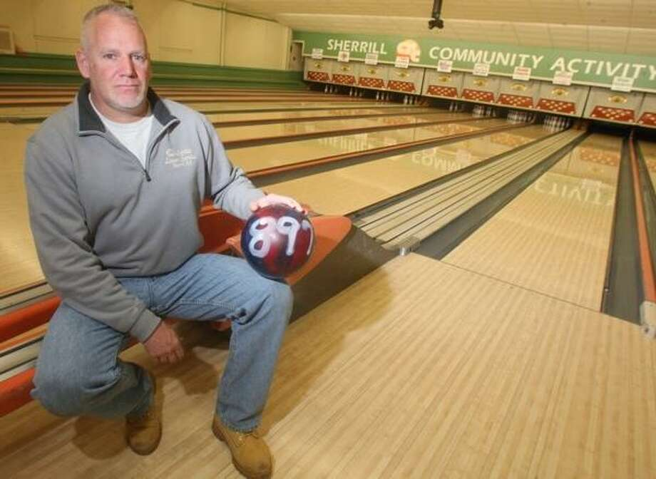John Haeger @OneidaPhoto on Twitter/Oneida Daily Dispatch Jim Quinn poses at the CAC in Sherrill on Wednesday. Quinn recently bowled a building-record 897 series on the lanes. Photo: Oneida Daily Dispatch / Oneida Daily Dispatch