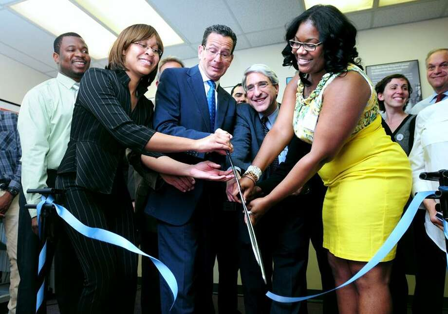 Left to right, New Haven Works graduate Osikhena Awudu watches New Haven Works member Angela Moore, Governor Dannel Malloy, Yale President-Elect Peter Salovey and New Haven Works volunteer Kamilia Norfleet cut the ceremonial ribbon at the grand opening of New Haven Works at 205 Whitney Ave. in New Haven on 6/5/2013.Photo by Arnold Gold/New Haven Register   AG0501C