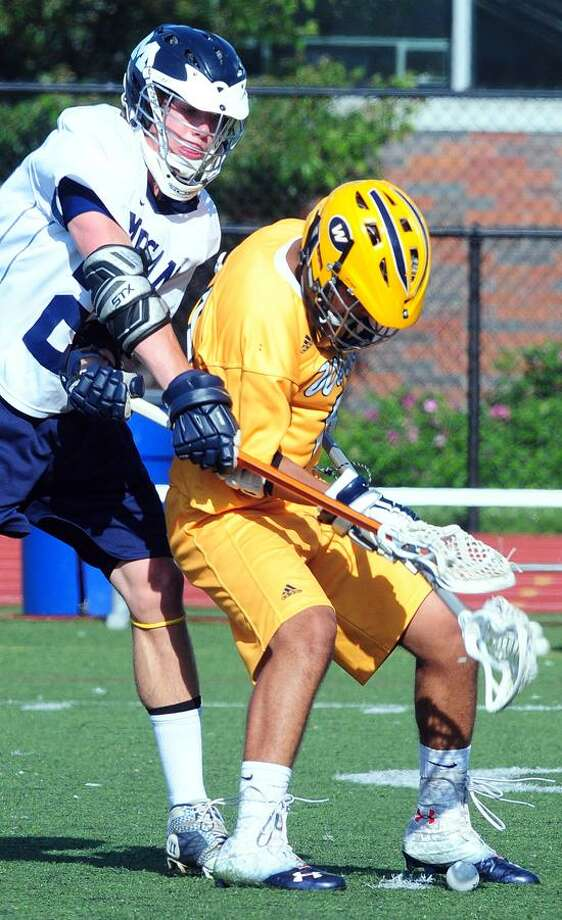 Marc Simmons (left) of Morgan and John DeLara (right) of Weston fight for the ball in the CIAC Class S Semifinal in Fairfield on 6/5/2013.Photo by Arnold Gold/new Haven Register