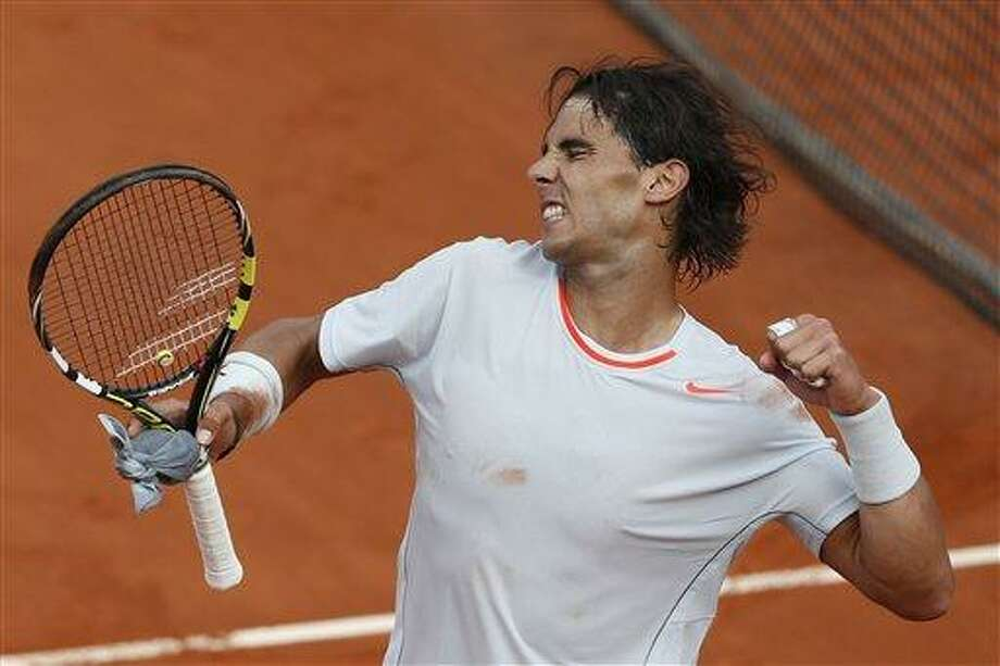 Spain's Rafael Nadal celebrates defeating Switzerland's Stanislas Wawrinka in three sets 6-2, 6-3, 6-1, in their quarterfinal match at the French Open tennis tournament, at Roland Garros stadium in Paris, Wednesday June 5, 2013. (AP Photo/Petr David Josek) Photo: AP / AP