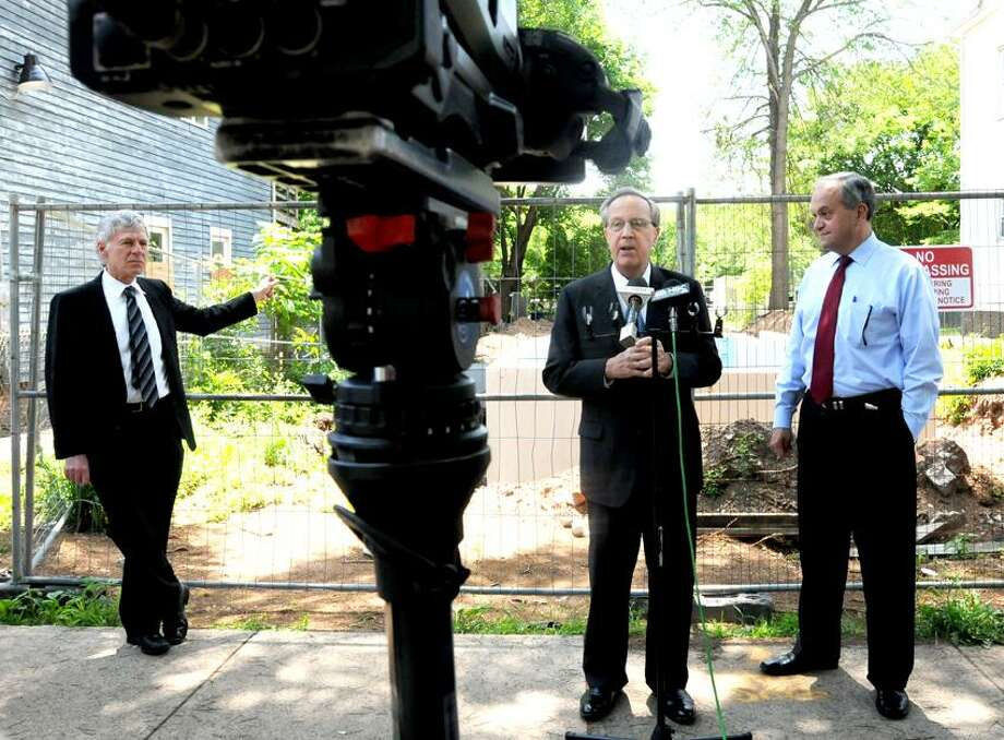 Jim Paley, Executive Director of Neighborhood Housing Services, left, Yale President Richard Levin, center, and New Haven Mayor John DeStefano, Jr. , right,  announce Wednesday, June 5, 2013,  a partnership that will allow a house to be built at 32 Lilac Street in Newhallville. Mayor DeStefano said that the city and Yale will split the $125,000 needed to finish construction on the single family home, according to a press release  by the City of New Haven.  Photo by Peter Hvizdak / New Haven Register Photo: New Haven Register / ©Peter Hvizdak /  New Haven Register