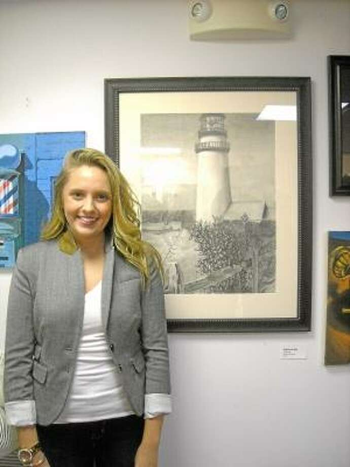 "Contributed Photo Jessica Nichol, of Torrington, with her graphite drawing, ""Guiding Light."""
