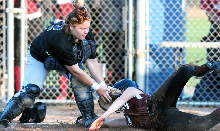 Brianna Spadacenta (left) of East Haven is late with the tag as Jen Szilagyi (right) of Granby scores in the second inning of the CIAC Class M semifinal in West Haven on 6/5/2013.Photo by Arnold Gold/New Haven Register