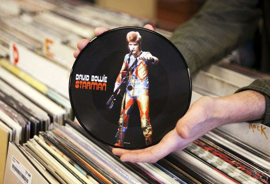 Amazon will give customers a free digital copy of any vinyl record purchased from its online store. The Associated Press file photo.