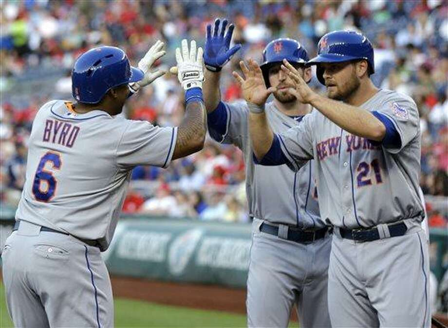 New York Mets' Marlon Byrd (6) celebrates with Ike Davis (29) and Lucas Duda (21) after Byrd's two-run home run during the second inning of a baseball game against the Washington Nationals at Nationals Park on Wednesday, June 5, 2013, in Washington. (AP Photo/Alex Brandon) Photo: AP / AP