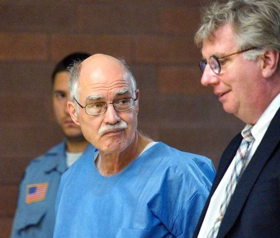 "Meriden-- Bob Raymond, with his lawyer Tom Conroy is arraigned in Meriden court for alleged bank robberies in Hamden on Tuesday.  Photo-Peter Casolino/Register <a href=""mailto:pcasolino@newhavenregister.com"">pcasolino@newhavenregister.com</a>"