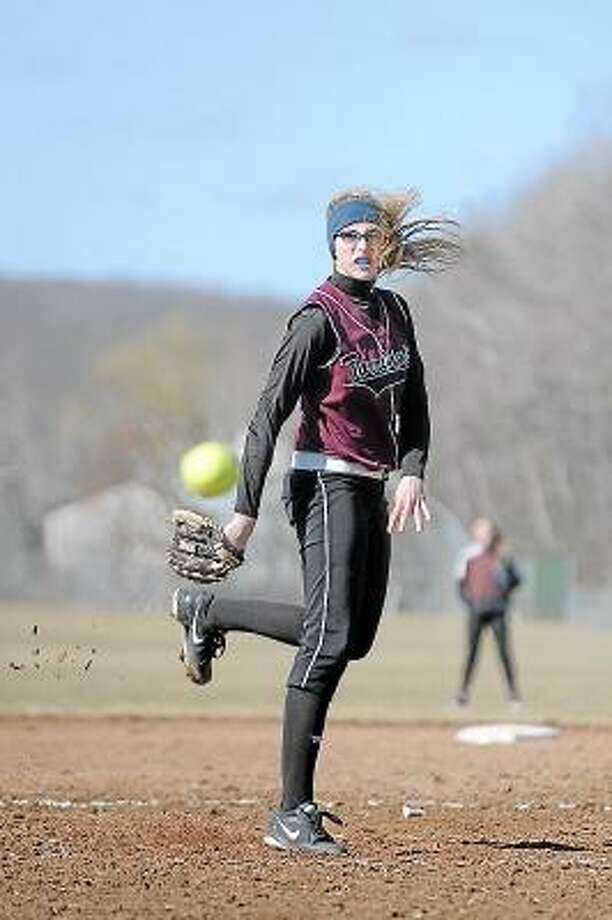 Laurie Gaboardi/Register Citizen  Torrington Sydney Matzko pitches during the Raiders' first game of the season against Holy Cross