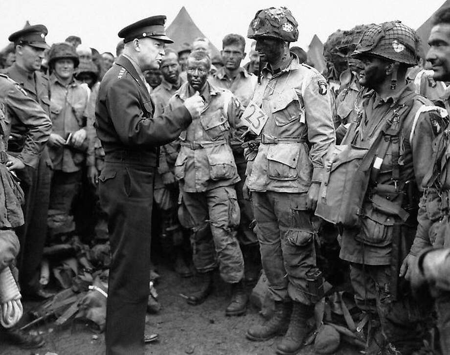 "In this image provided by the U.S. Army, General Dwight D. Eisenhower, gives the order of the day, ""Full victory--nothing else"" to paratroopers somewhere in England on June 6, 1944 just before they board their airplanes to participate in the first assault in the invasion of the continent of Europe. (AP Photo/U.S. Army) Photo: AP / 2011 AP"