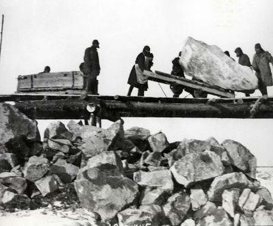 Men unloading stones at the White Sea-Baltic Sea Canal, which was built by forced labor from gulags. Thousands died during its construction. The Russian human rights group Memorial has collected thousands of objects from former gulag prisoners, including photos, that detail the daily brutality they experienced. Many are on display in a new exhibit in Berlin.