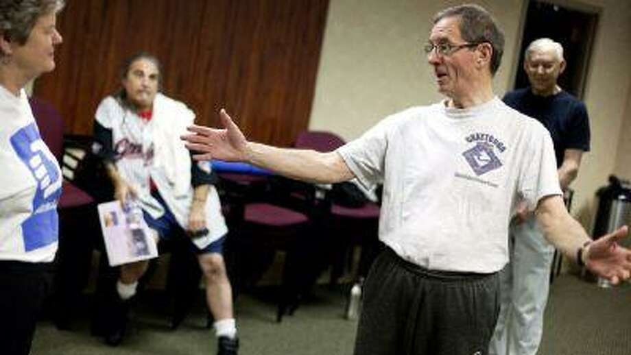 In a Wednesday, April 25, 2012 photo, cancer survivor Lawrence Gentner, 68, of Snellville, Ga., talks with his exercise group after a class, in Atlanta. (AP)