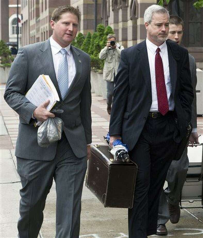 Meriden, Conn., police officer Evan Cossette, left, and his attorney Raymond Hassett arrive at the U.S. Courthouse in New Haven, Conn., Wednesday, May 29, 2013, for the second day of his trial. Cossette, the son of Meriden Police Chief Jeffry Cossette, is accused of brutality by shoving a handcuffed man in the police department lockup in 2010. (AP Photo/Record-Journal, Christopher Zajac) Photo: AP / Record-Journal
