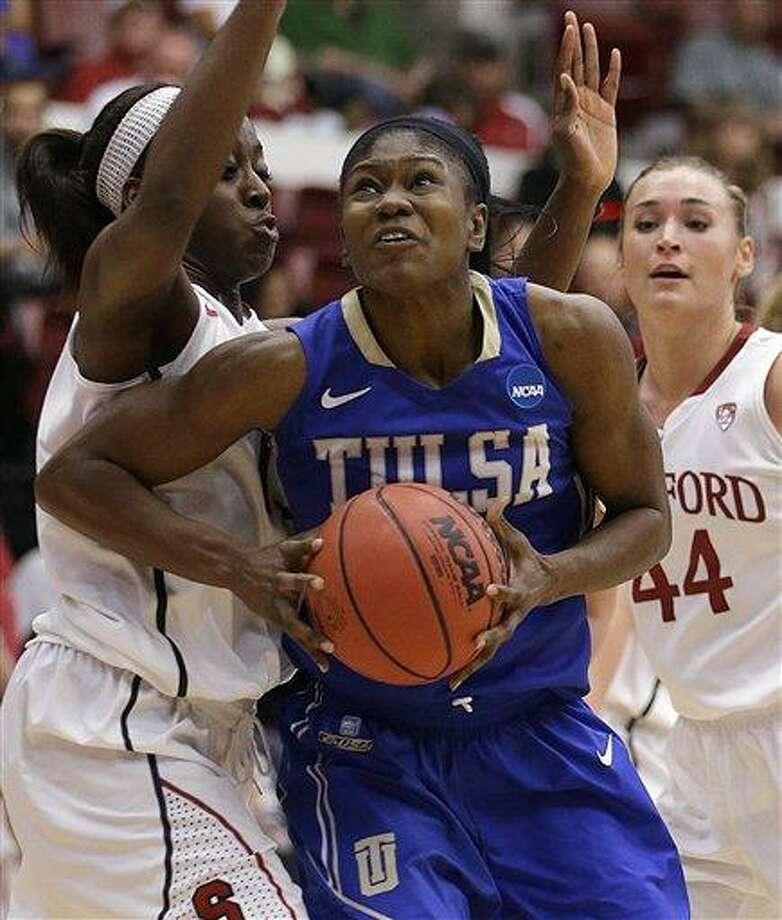 Tulsa's Tiffani Couisnard, center, looks to shoot against Stanford's Chiney Ogwumike, left, and Joslyn Tinkle (44) during the first half of a first-round game in the women's NCAA college basketball tournament on Sunday, March 24, 2013, in Stanford, Calif. (AP Photo/Ben Margot) Photo: AP / AP