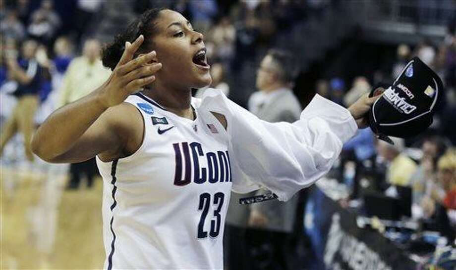 Connecticut forward Kaleena Mosqueda-Lewis celebrates after beating Kentucky in the women's NCAA regional final basketball game in Bridgeport, Conn., Monday, April 1, 2013. Mosqueda-Lewis scored 17 points in the Connecticut 83-53 win advancing them to the Final Four. (AP Photo/Charles Krupa) Photo: AP / AP